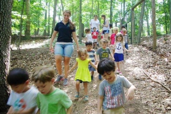 Counselor Rebecca Unger, dark shirt, takes children to the Stone House from the Cora Hartshorn Arboretum's grounds Aug. 10. Assisting are volunteers Emily Wertheimer, back left, and Erica Einhorn. A number of programs are scheduled at the arboretum this fall.
